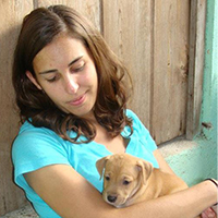 Sara with a small puppy