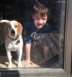Lilly and Jayden, age 6, keep an eye out for Matt Wilson's return from work.